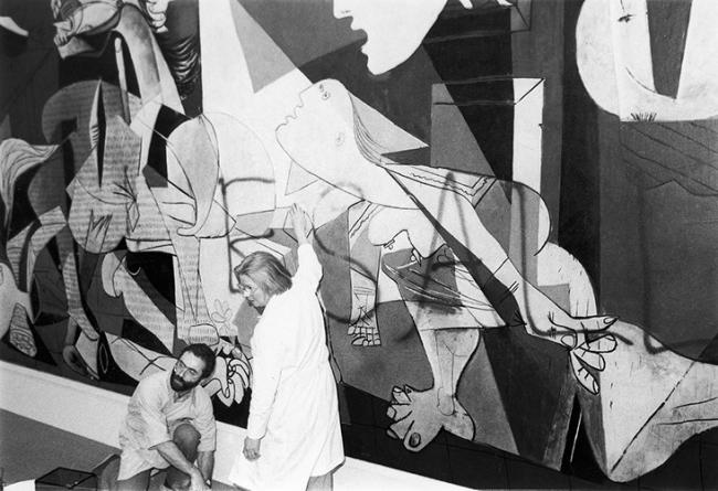 The cleaning of Guernica by two restorers after Toni Shafrazi's graffiti