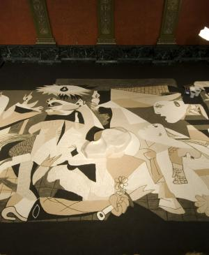 Guernica in sand