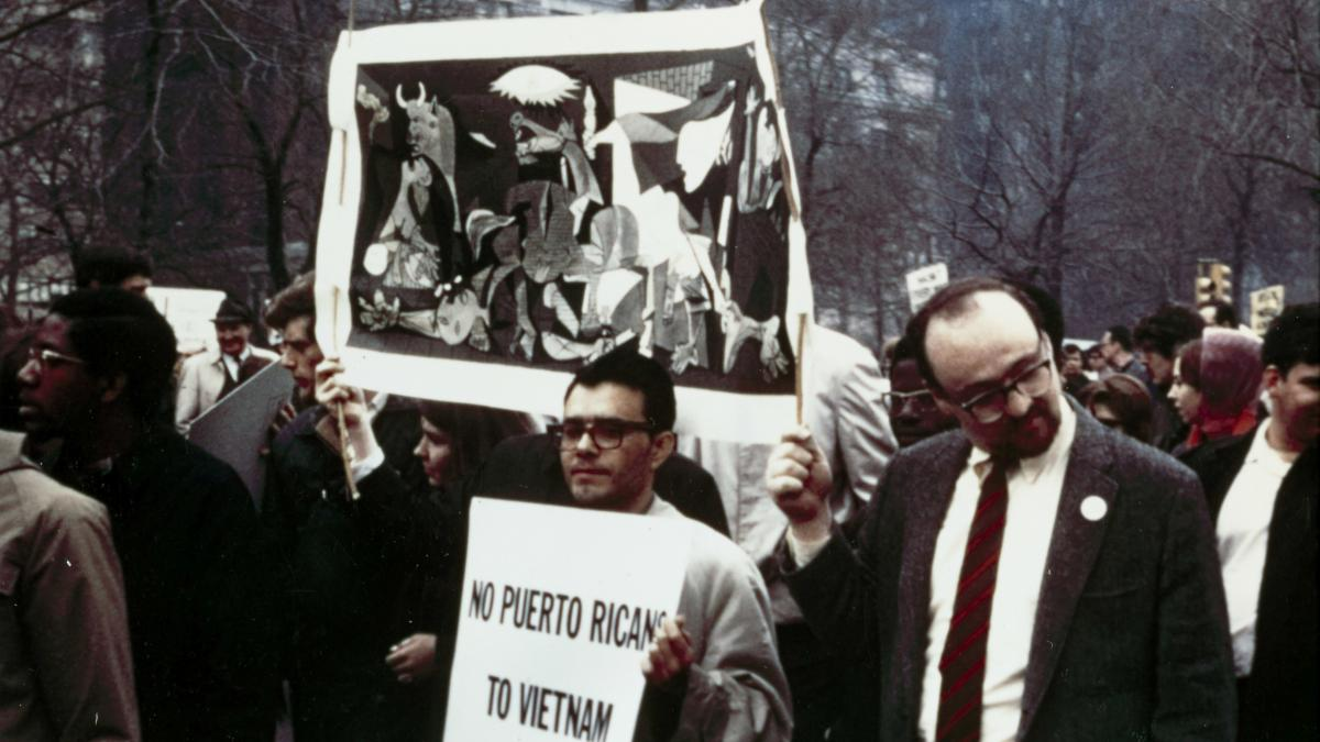 Vietnam protest rally in Central Park with a banner bearing the image of Guernica
