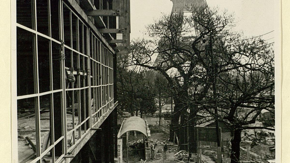 The Spanish Pavilion under construction with the Eiffel Tower in the background