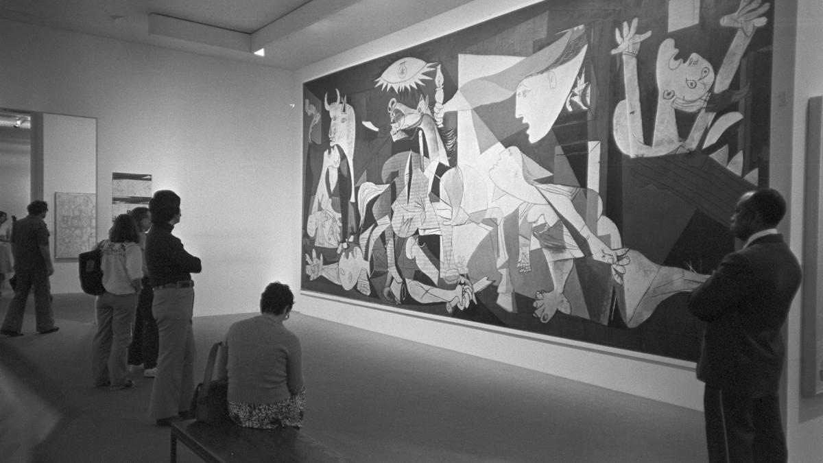 Visitors contemplating Guernica in New York's Museum of Modern Art